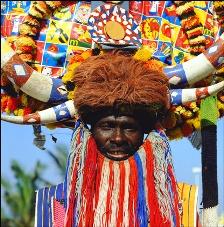 Zulu Ricsha Driver in colourful dress